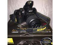 Nikon D5000 DSLR Camera + Kit lens + 3 further lenses. £450.