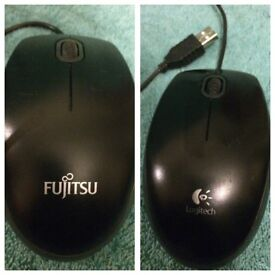 2 computer mouses and a mat