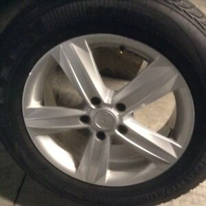 Winter tires 225/65/17 with mags 5x120 like new