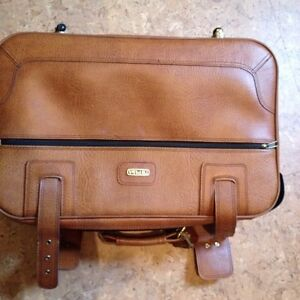 Brown leather suitcase with wheels