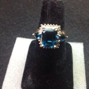 # 11-10K , Stunning Blue Topaz  Diamond Ring