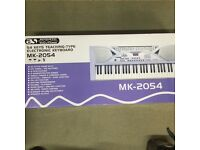 54 key electronic learning keyboard hardly used!!!