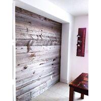 Reclaimed wood accent walls, flooring and sliding barn doors