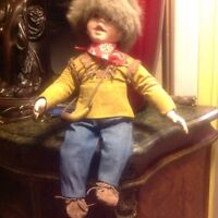 VINTAGE CANADIAN BOY DOLL WITH RACOON HAT AND HORN