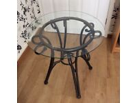 Glass and metal occasional table