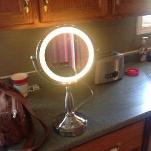 Light up two sided mirror