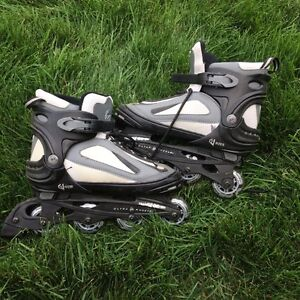 Roller blades  adjustable to 4 sizes