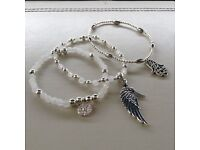 Set of three silver and white jade stacking bracelets