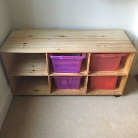 Wooden storage cabinet with plastic buckets
