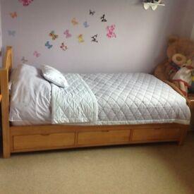 Children's single bed with storage draws