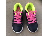 Size 1 heeley type trainers