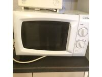 Microwave, kettle, toaster & dish drainer.