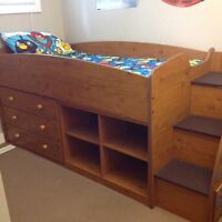 Loft bed with dresser built into stairs