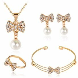 A Suit of Stylish Faux Pearl Rhinestone Bow Necklace Bracelet Ring and Earrings