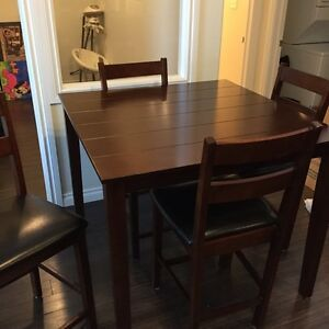 Beautiful table and leather chairs need gone today