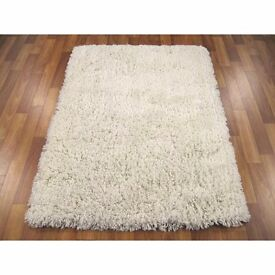 Two white shaggy rugs