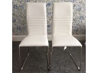 Two brand new white leather chairs