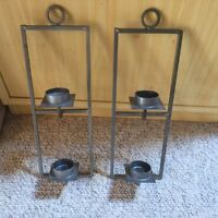 Hanging metal candle holders