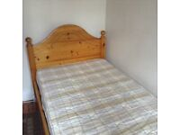 Pine single bed with memory foam mattress and bedding