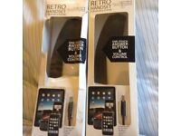 Two phone/tablet handsets