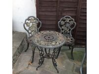 CAST IRON GARDEN TABLE AND 2 CHAIRS VERY HEAVY