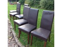6 Brown faux leather dining room chairs