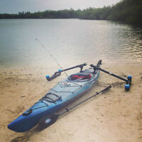 Kayak with removable stabilizers for fishing.