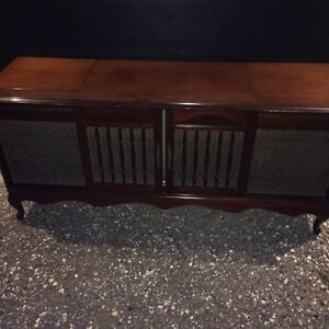 Vintage TV stereo with record player in wood console