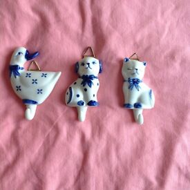 3 small ceramic hooks