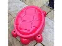 Children's turtle sandpit