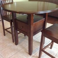 Round table with drop down wings and 2 chairs