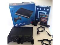 PS3 with controllers and game, great condition