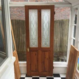 Door with glass panels.