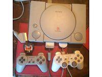 Playstation 1 bundle, 17 games, 2 controllers & steering wheel