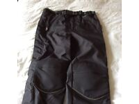 Texpeed waterproof textile armoured motorcycle trousers.
