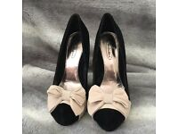 Size 5 high heel shoes.