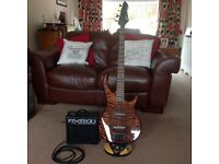 Reavey bass guitar and amp, tuner,strap, soft case, tuition book and cd.