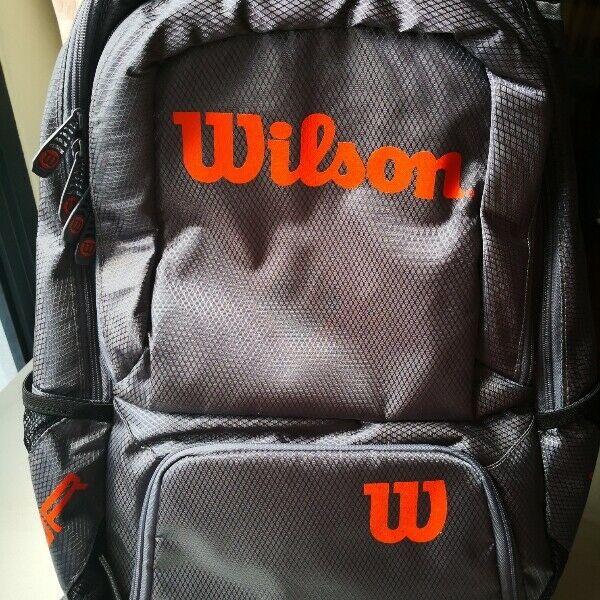 *New* Wilson tennis bag. Hold two racquets, light, spacious and waterproof. Genuine wilson Tour