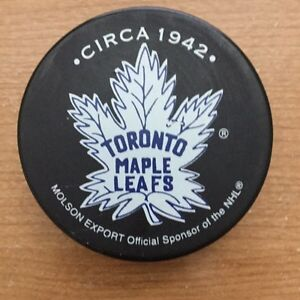 Hockey pucks Toronto Boston Rangers