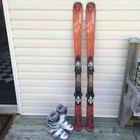 Skis, bindings, boots, helmet, and goggles