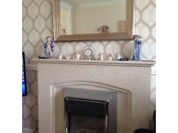 Cream marble fire place and fire