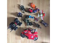 Mixture of toy cars, bikes, and figures