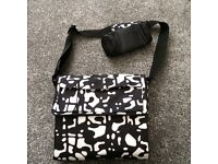 Changing may bag with bottle carrier