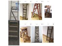 Various vintage wooden ladders