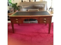 Large mahogany desk with brass handles and leather top