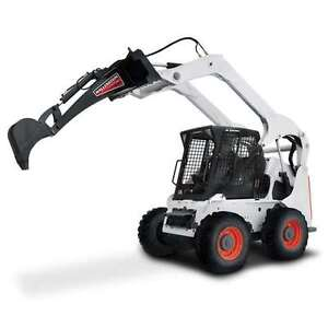 Backhoe with skid steer mount