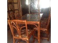Cane dining table and six chairs