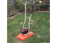Petrol 2-stroke Flymo hover mower