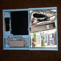 Nintendo Wii with accessories and games.