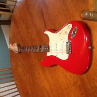 Electric guitar .  Need a new string and it kinda hums when amp